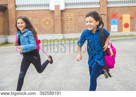 Some Nice Kids On The School Background Having Fun