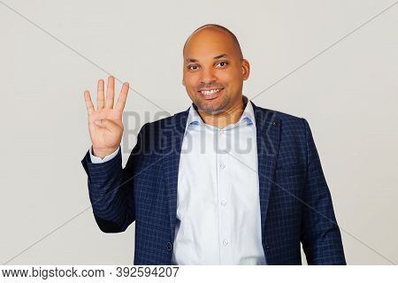 Portrait Of A Successful Young African American Businessman Guy, Showing With Fingers To Number Four