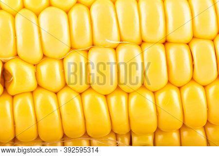 Close-up Shot Of A Peeled Ripe Corncob. Food Background Concept.