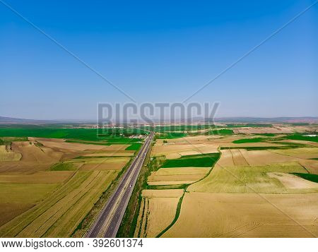Aerial View To The Fertile And Arable Fields In The Spring Season Ready For Sowing