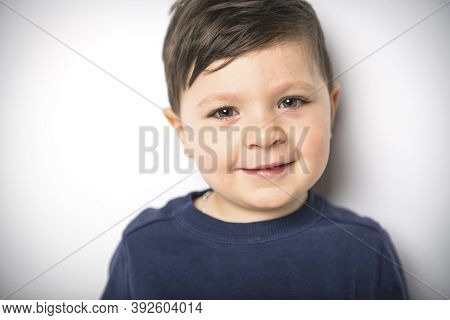 Close Portrait Of A Four Years Old Boy Over White