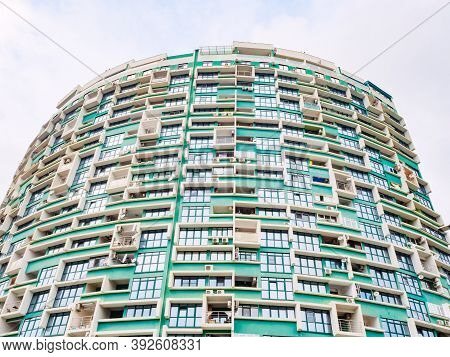 Russia, Sochi 18.02.2020. This Is A Modern Green Highrise Residential Building Built In A Semicircle