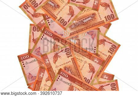 100 Sri Lankan Rupees Bills Flying Down Isolated On White. Many Banknotes Falling With White Copyspa