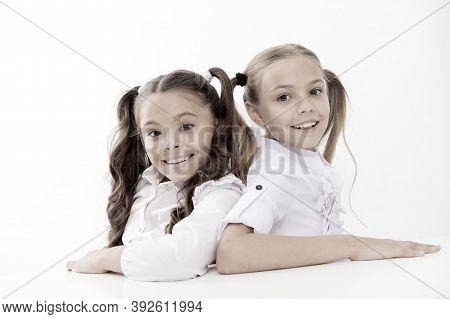 Simply Beautiful. Cheerful Smart Schoolgirls. Happy Schoolgirls Isolated On White. Small Schoolgirls