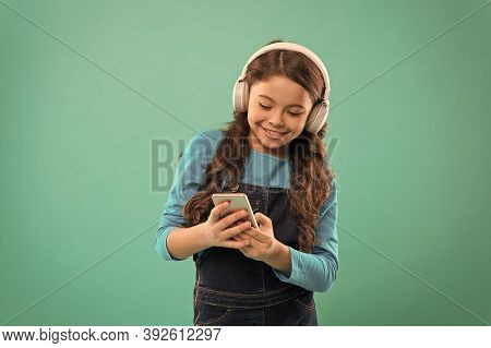 Play Game. Subscription Channel. Girl Child Listen Music Modern Headphones And Smartphone. Listen Fo