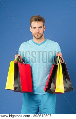 Capture Opportunity. Man Bearded Face Holds Shopping Bags. Guy Bought Lot Sporty Clothes And Accesso