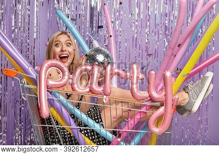 Overjoyed Playful Blonde Female Fools Around And Has Fun, Prepares For Bridal Shower, Poses In Shopp