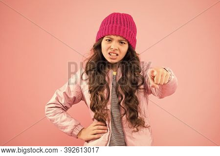Bullying And Shaming. Little Girl Winter Clothes Pink Background. Childhood Concept. Emotional Girl
