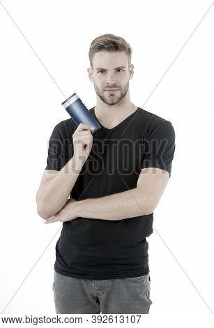Man Bearded Stylish Hold Plastic Shampoo Bottle. Guy Handsome Use Popular Cosmetic Or Hygienic Shamp