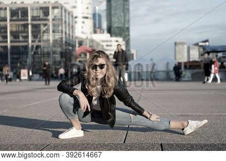 Woman Athlete Or Dancer Split Leg In Paris, France. Sensual Woman With Long Hair In Sunglasses And J