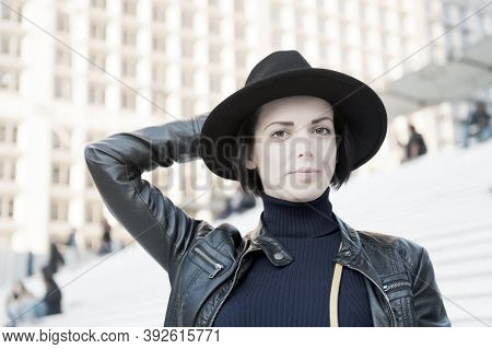 Sensual Woman With Brunette Hair, Hairstyle. Woman In Black Hat Pose On Stairs In Paris, France, Fas