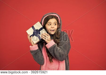 Child In Rabbit Kigurumi. Happy Girl In Cute Pajamas. Lifestyle Concept. Rest And Relax. Child In Pa