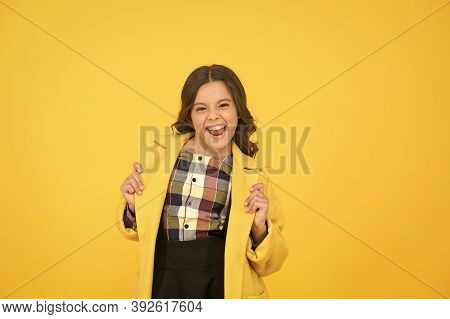 Yellow Mood. Fancy Child Smiling Face On Yellow Background. Yellow Color. Girl Fashionable Cute Mode