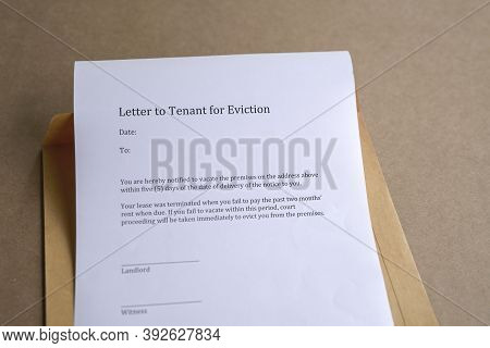 Letter To Tenant For Eviction, On Top Of Brown Envelope
