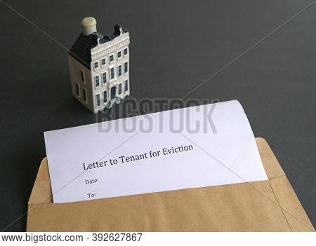 Letter To Tenant For Eviction Inside Brown Envelope.