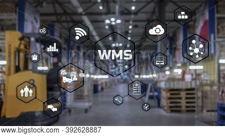 Inscription Wms On Blurred Warehouse Background. Werehouse Management System.