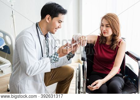 Man Doctor With Wrapping Nurse Bandages Splint To The Arm Of A Female Patient Wear Arm Splint With A