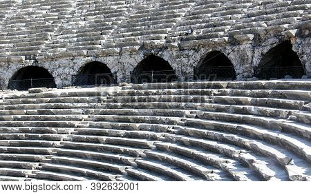 Side Amphitheatre was built by Romans in 2nd Century AD replacing the Hellenistic theatre which was there prior to it. It is located in Turkey.