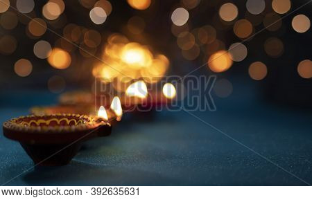 Colorful Clay Diya Lamps Lit During Diwali Celebration,