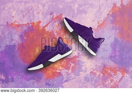 Purple Sneaker On Old Concrete Floor Background.