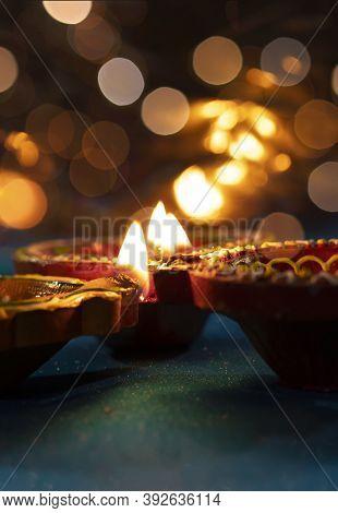 Beautiful Clay Diya Lamps Lit During Diwali Celebration,