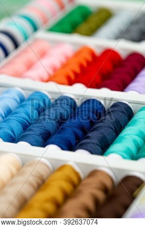 A Set Of Threads In Different Colors. Multicolored Threads For Sewing And Needlework. Small Rolls Of