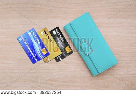 Top View Of Wallet And Credit Cards On Wood Table Background.