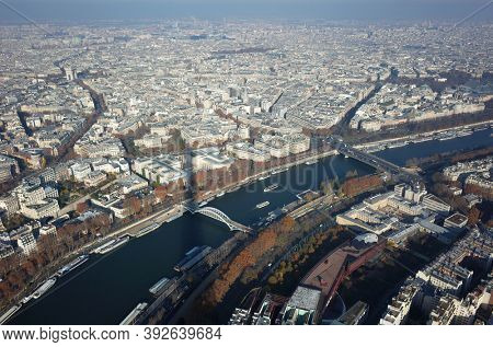 Paris, France - November 21, 2018: Shadow of the Eiffel tower on Paris cityscape and Seine river view from Eiffel Tower
