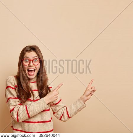 Pleased Charismatic Woman With Overjoyed Expression, Wears Transparent Glasses, Has Long Hair, Dress