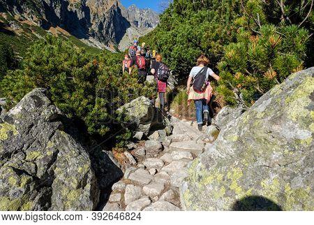 Vysoke Tatry, Slovakia - October, 2018: Hikers On Trail At Great Cold Valley,  Vysoke Tatry (high Ta