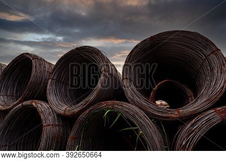 Steel Wire Coil Against Dark Sky. Metal Steel Reinforced For Concrete Construction. Iron Wire For Co