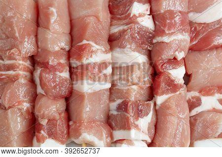 Close Up Of Six Raw Souvlaki, Top View, Meat Background