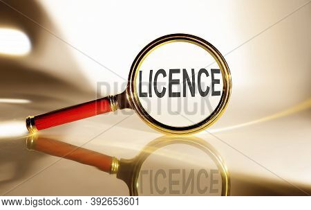 Licence Concept. Magnifier Glass With Text On White Background In Sunlight.