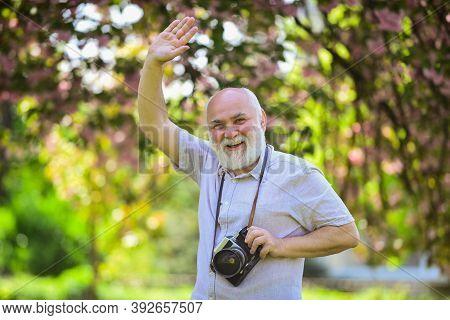 Emotions Through Photos. Hobby And Leisure. Experienced Photographer In Spring Garden. Senior Man Sh