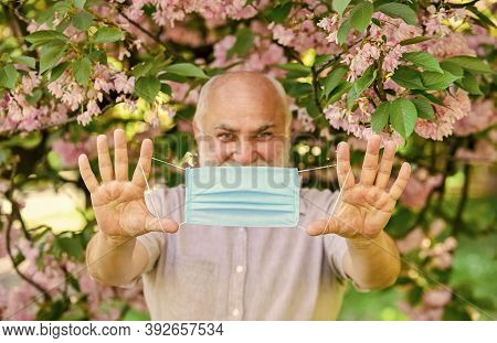 Senior Man Face Mask. Respiratory Mask. Pollen Allergen. Man And Flowers. Allergic Reaction. Limit R