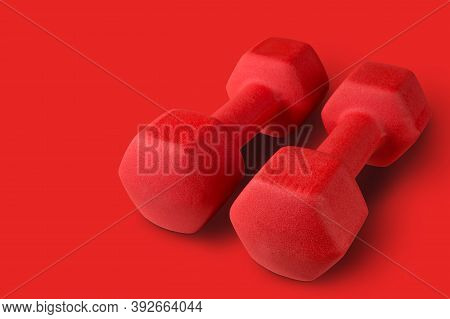 Pair Of Big Red Dumbbells On Red Background, Concept, Copy Space