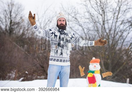 Active Lifestyle. Snow Games. Leisure On Fresh Air. Man Cheerful Bearded Hipster Knitted Hat And War