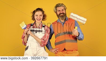 Pick Color. Diy Repair. Construction Workers. Home Renovation. Cheerful Couple Renovating House. Pai