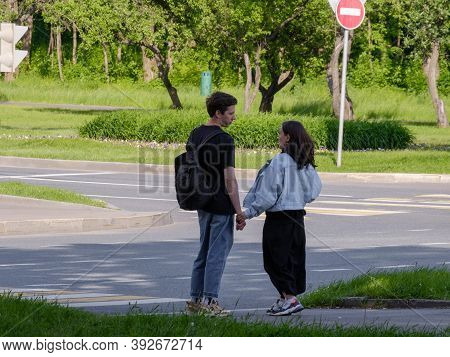 Moscow, Russia. June 14, 2020. A Pair Of Lovers At A Crossroads In Front Of A Pedestrian Crossing On