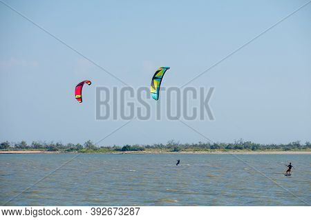 Yasenskaya Ferry. Russia. August 18, 2020 Sea View With Kitesurfing Athletes. Kitesurfers Rush At Hi