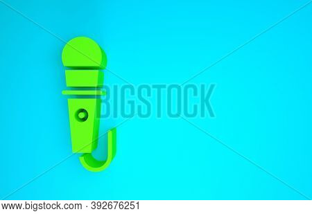 Green Microphone Icon Isolated On Blue Background. On Air Radio Mic Microphone. Speaker Sign. Minima