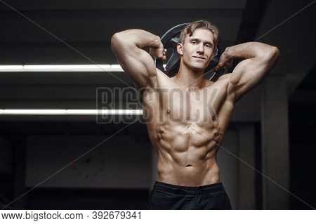 Fitness Man At Workout In Gym With Bodybar Stretching Muscles. Workout Fitness And Bodybuilding Heal
