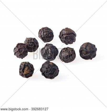 Close-up Of Black Pepper Isolated On A White Background.
