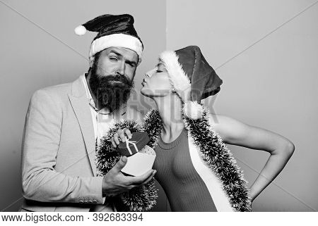 Office Christmas Party. Happy Man And Woman Wear Santa Hats. Cheerful Couple Celebrate New Year. Chr