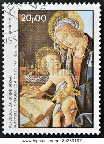 GUINEA BISSAU - CIRCA 1985: a stamp printed in Guinea-Bissau showsthe Virgin and Child by Botticelli