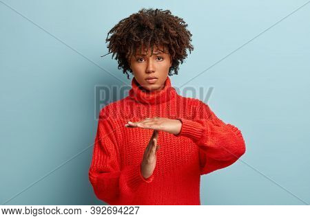 Studio Shot Of Sad Dissatisfied Tired Frustrated Woman Shows Timeout Gesture, Needs Stop, Asks Time