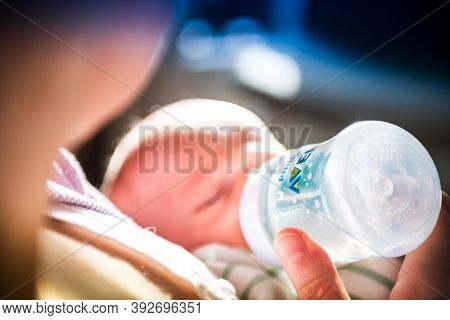 Paris, France - Oct 28, 2020: Woman Giving Formula To Infant Baby In The Philips Avent Baby Bottle -