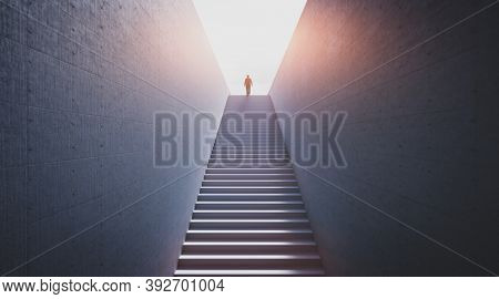 Man going upstairs towards open world full of light. Concept of hope, new better world, bright future. 3D illustration