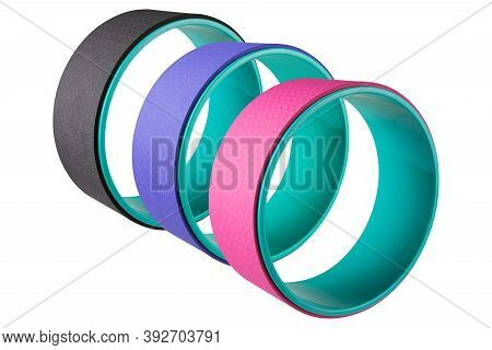 Three Colored Yoga Wheels Stand Upright In A Row, On A White Background, Isolate