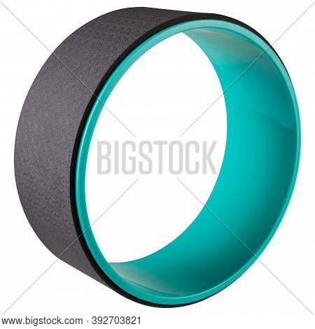 One Yoga Wheel Stands Upright, On A White Background